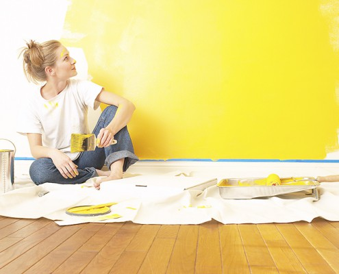 lady-painting-wall-yellow-fresh-new-website